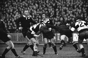 JPR Williams is high-tackled for the Barbarians against the All Blacks in 1973