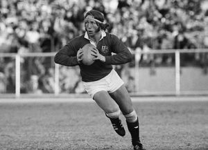 JPR Williams runs with the ball for the British Lions