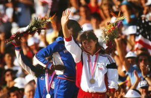 Kathy Cook waves to the crowd on the podium at the 1984 Los Angeles Olympics
