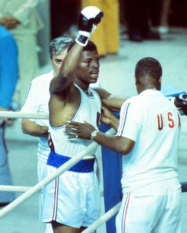 Leon Spinks celebrates his gold medal at the 1976 Montreal Olympics