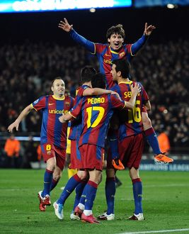 Lionel Messi celebrates with his Barcelona teammates