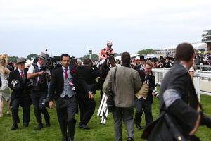 Luke Nolan and Black Caviar are surrounded by photographers at Royal Ascot