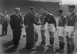 Manchester City goalkeeper Bert Trautmann shakes hands with Prince Philip - 1956
