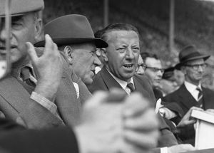 Manchester United manager Matt Busby sits on the bench with caretaker manager Jimmy