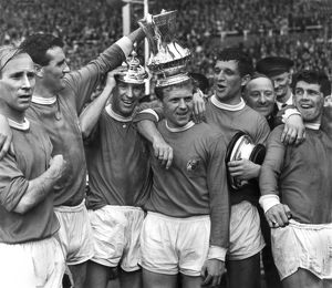 Manchester United players celebrate after winning the FA Cup in 1963