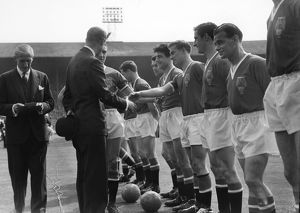Manchester United's Bobby Charlton shakes hands with Prince Philip before the