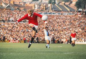 Manchester United's Denis Law shoots at goal