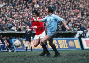 Manchester United's Willie Morgan and Coventry's Roy Barry