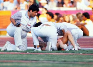 Mary Decker lies on the ground after crashing out of the 1984 Olympic 3000m final