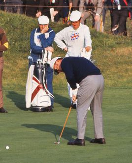 Miller Barber putts during the 1969 Ryder Cup