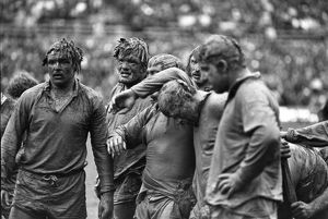 Mud-covered British Lions forwards face the Junior All Blacks in 1977