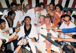 Muhammad Ali and Joe Bugner at the press conference after their second fight, in 1975