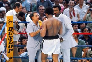 Muhammad Ali receives some last words of advice from his corner before taking