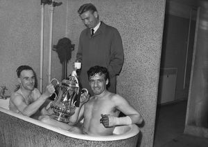 Newcastle United's Ron Batty and Ronnie Simpson celebrate winning the 1955 FA Cup