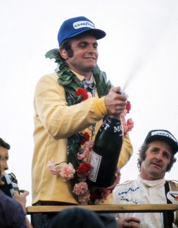 Peter Revson celebrates after winning the 1973 British Grand Prix