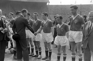 Prince Philip is introduced to the Manchester United players before the 1958 FA Cup Final