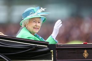 The Queen waves to the crowd at Royal Ascot