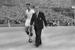 Ray Wood leaves the field injured in the 1957 FA Cup Final