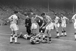 Ray Wood and Peter McParland go down injured in the 1957 FA Cup Final