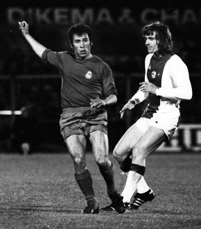Real Madrid's Amancio and Ajax's Rudi Krol