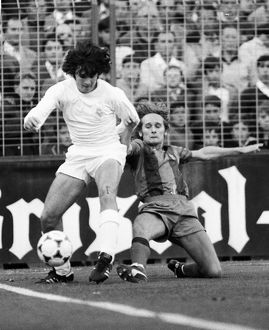 Real Madrid's Jose Antonio Camacho is challenged by Barcelona's Allan Simonsen