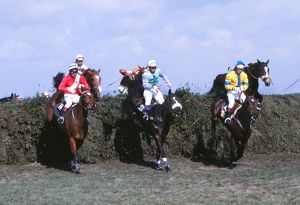 Rubstic, centre, on the way to winning the Grand National