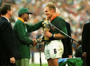 Springbok captain Francois Pienaar receives the Webb Ellis Cup from President Nelson
