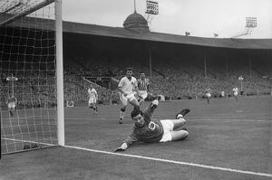 Stand-in goalkeeper Jackie Blanchflower makes a save during the 1957 FA Cup Final