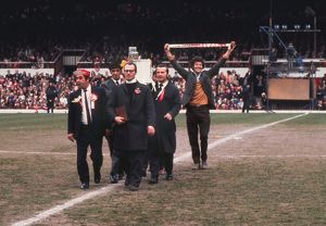 Sunderland carry their 'Leeds died 1973' coffin to the Roker Park centre-circle