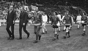 Sunderland manager Bob Stokoe (right) and Leeds United manager Don Revie lead out