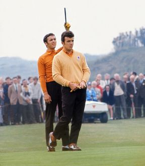 Tony Jacklin and Peter Townsend line up a putt at the 1969 Ryder Cup