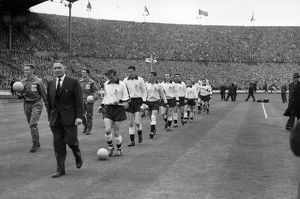 Tottenham Hotspur manager Bill Nicholson leads his Tottenham team onto the pitch