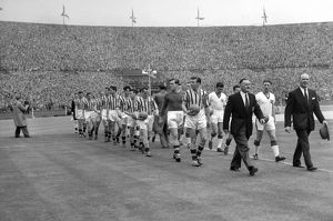 United manager Matt Busby and Villa manager Eric Houghton lead their side's out