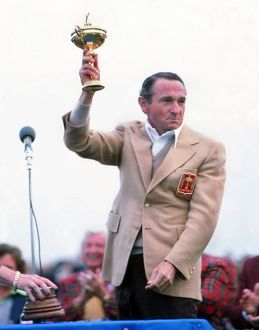 United States captain Dow Finsterwald lifts the Ryder Cup in 1977