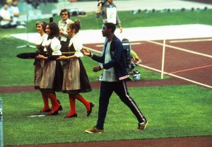 Vince Matthews casually swings his 400m Olympic gold medal after the ceremony in 1972
