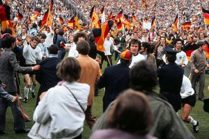West German players run of the field as fans invade the pitch after victory in Euro 72