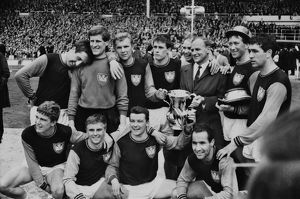 West Ham manager Ron Greenwood celebrates victory with his players after the 1964