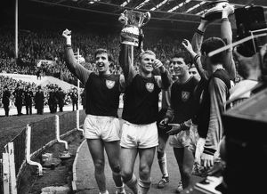 West Ham players Ken Brown, Bobby Moore and Peter Brabrook parade the FA Cup after